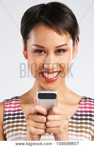 Young Woman Reading Text Message On Phone