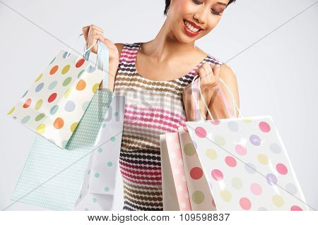 Studio Shot Of Funky Woman With Shoppping Bags