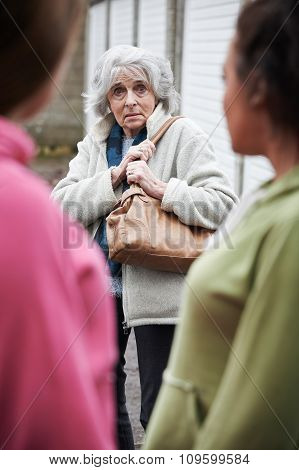 Senior Woman Feeling Intimidated By Teenage Girls