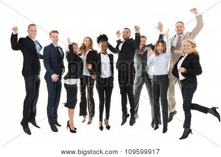 Full Length Of Happy Business Team Celebrating Success