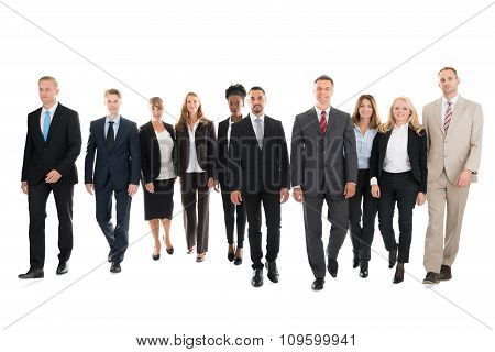Confident Business Team Walking Against White Background