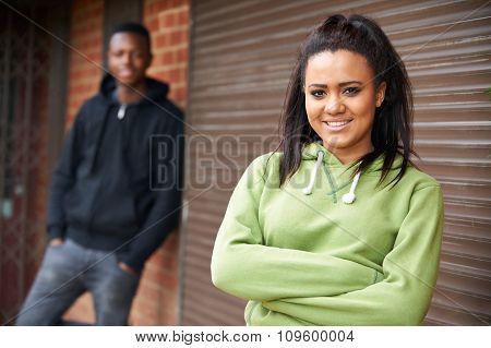 Portrait Of Teenage Couple In Urban Setting