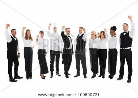 Portrait Of Happy Restaurant Staff Celebrating Success
