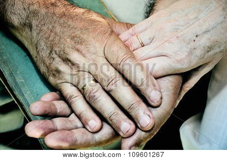 Tinted Color Image Of Old Married Couples Hands. Horizontal