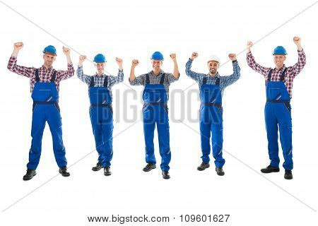 Portrait Of Successful Male Carpenters Standing In Row