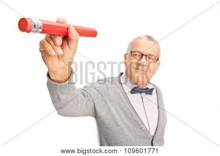 Mature teacher erasing something with the backside eraser of a pencil isolated on white background