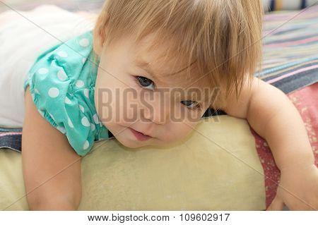 Little Girl Looking Slyly