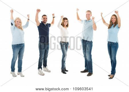 Confident People In Casuals Standing With Arms Raised