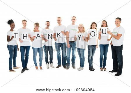 Confident Volunteers Showing Thank You Sign