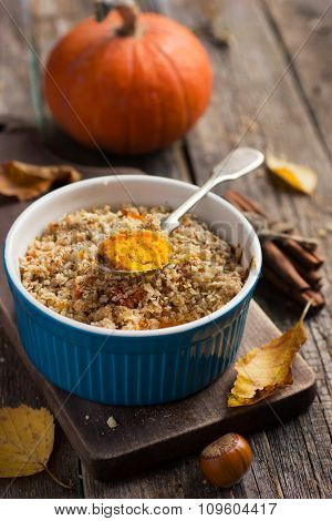 Sweet Pumpkin And Apple Crumble  On Blue Ramekin