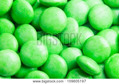 Close Up On Pile Green Milk Chocolate Candies Crisp Shell