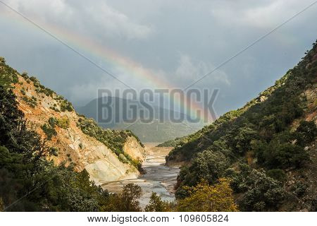 Scenic View From The Mountain To The River And Rainbow