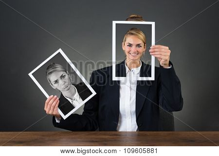 Woman Holding Photos With Different Expressions