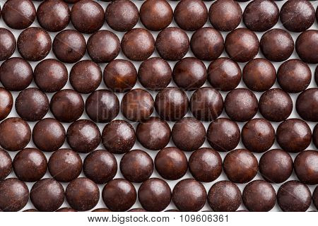 Close Up Neatly Arranged Brown Milk Chocolate Candies Crisp Shell