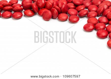 Top Right Frame Of Red Chocolate Candy On White Background