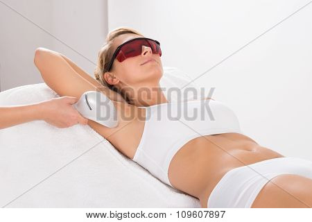 Woman Having Underarm Laser Hair Removal Treatment