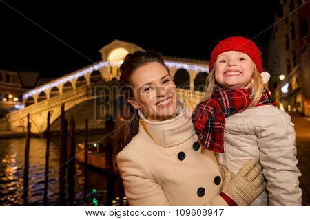 Happy Mother And Daughter Near Rialto Bridge In Christmas Venice