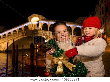 Happy Mother And Daughter With Christmas Tree In Venice, Italy.