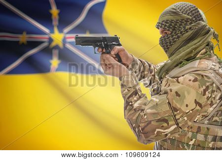 Male In Muslim Keffiyeh With Gun In Hand And National Flag On Background - Niue