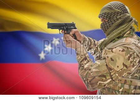 Male In Muslim Keffiyeh With Gun In Hand And National Flag On Background - Venezuela