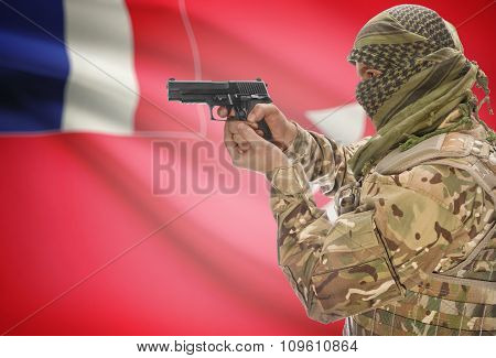 Male In Muslim Keffiyeh With Gun In Hand And National Flag On Background - Wallis And Futuna