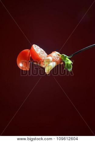Fork With Macaroni, Oregano And Tomatoes