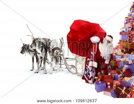 Santa Claus, his deer and many xmas gifts