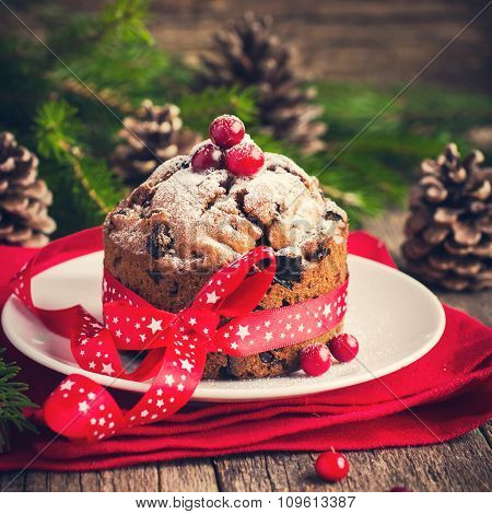 Traditional Fruitcake For Christmas Decorated With Powdered Sugar And Fresh Berry