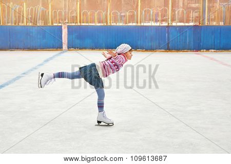 girl ice skating on rink