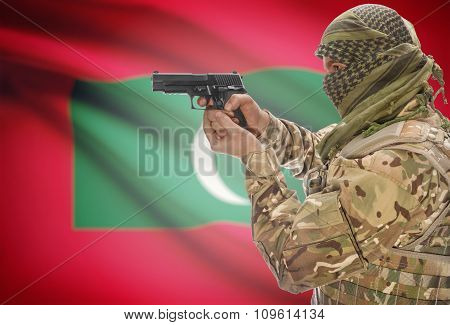 Male In Muslim Keffiyeh With Gun In Hand And National Flag On Background - Maldives