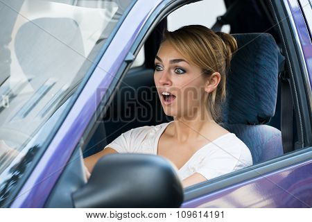 Shocked Woman Driving Car