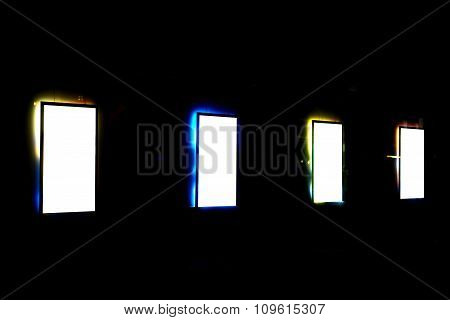 Clear banners with colorful frame on the city at night