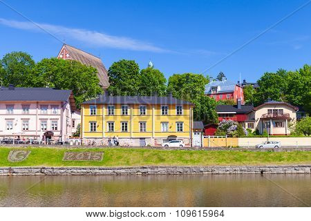 Colorful Houses On The River Coast In Finnish Town