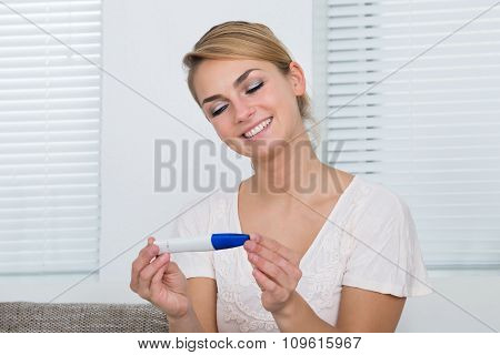 Woman Looking At Pregnancy Result At Home