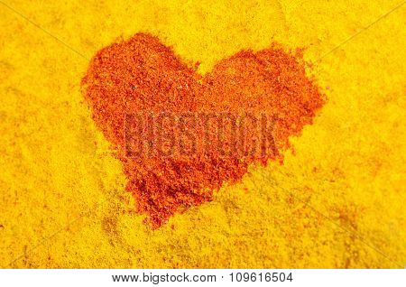 Red heart on a yellow background from spices