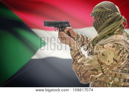 Male In Muslim Keffiyeh With Gun In Hand And National Flag On Background - Sudan