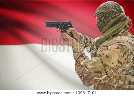 Male In Muslim Keffiyeh With Gun In Hand And National Flag On Background - Indonesia