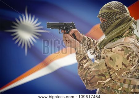 Male In Muslim Keffiyeh With Gun In Hand And National Flag On Background - Marshall Islands