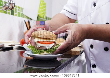 Chef Cooking And Decorated Hamburger
