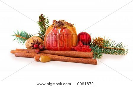 Baked apple with Christmas decoration isolated.