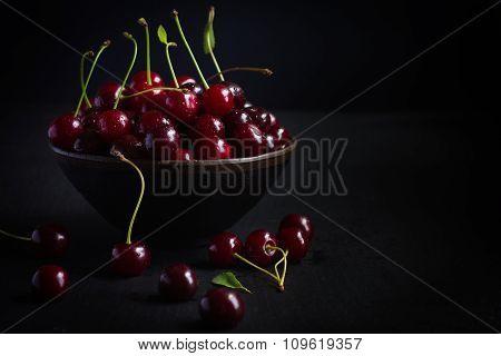 Fresh Cherry On Black Background