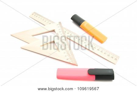 Markers And Wooden Ruler On White