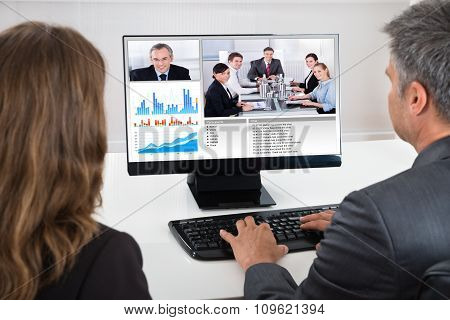 Two Businesspeople Participating In Video Conference