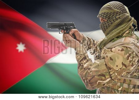 Male In Muslim Keffiyeh With Gun In Hand And National Flag On Background - Jordan