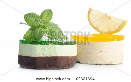 Two Cakes With Lemon And Mint On White Background