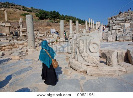 Lady In Muslim Scarf Walking Through Ruined Alley Of Greek-roman City Ephesus