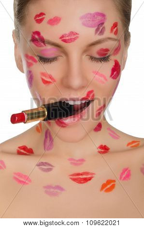 Woman With Kisses On Face And Lipstick In Mouth