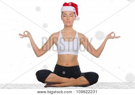 Asian Woman In Christmas Hat With Snow Practicing Yoga