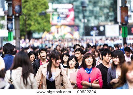 TOKYO, JAPAN - CIRCA MAY 2014: People walking at a busy street in Tokyo, Japan.