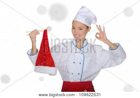 Smiling Asian Chef In Christmas Cap With Chopsticks Under Snow